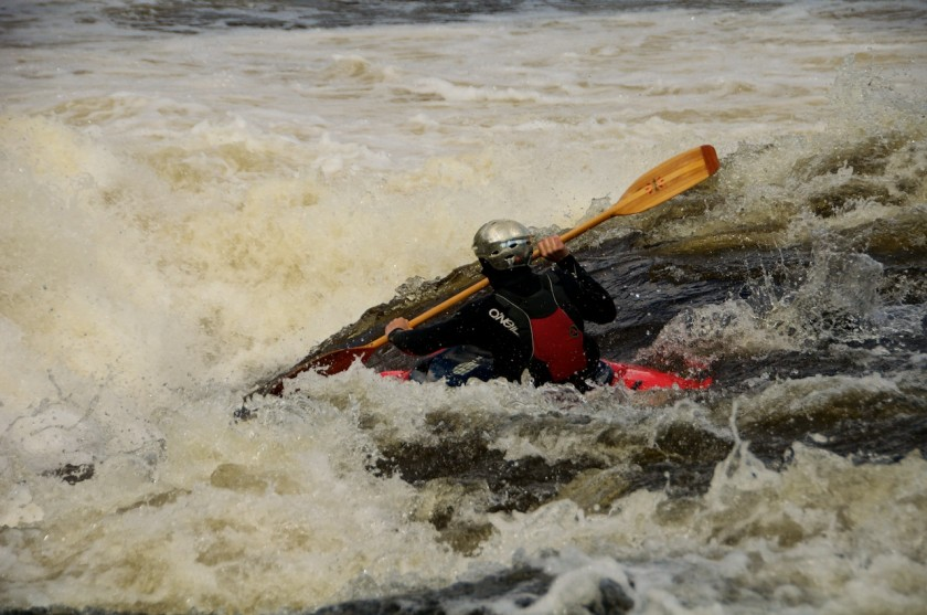 Jeff paddling down the ramp of Newsowadnehunk Falls on the West Branch of the Penobscot