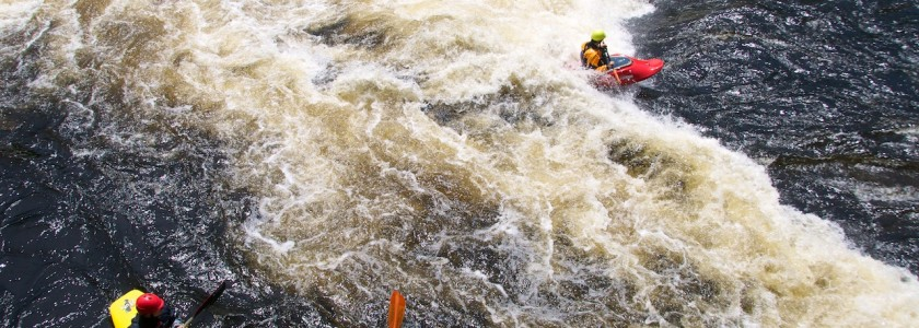 Jane surfing at Third Drop of Big A on the West Branch of the Penobscot.