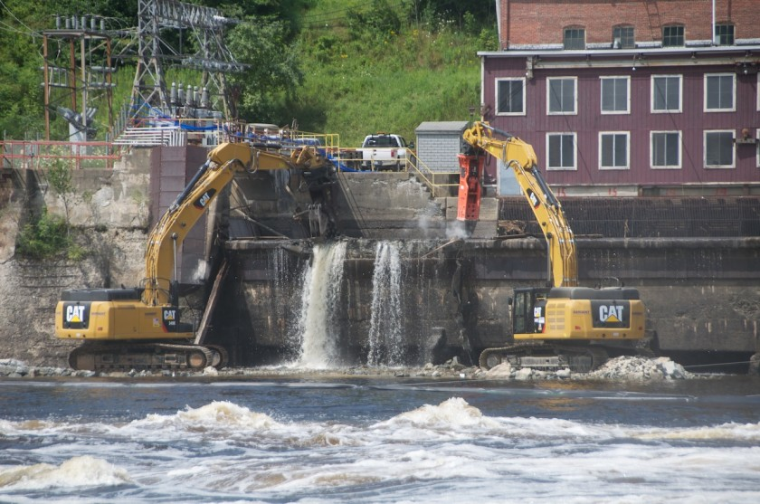 Excavators at Work tearing down the Veazie Dam with the Shang-Tu Cabin