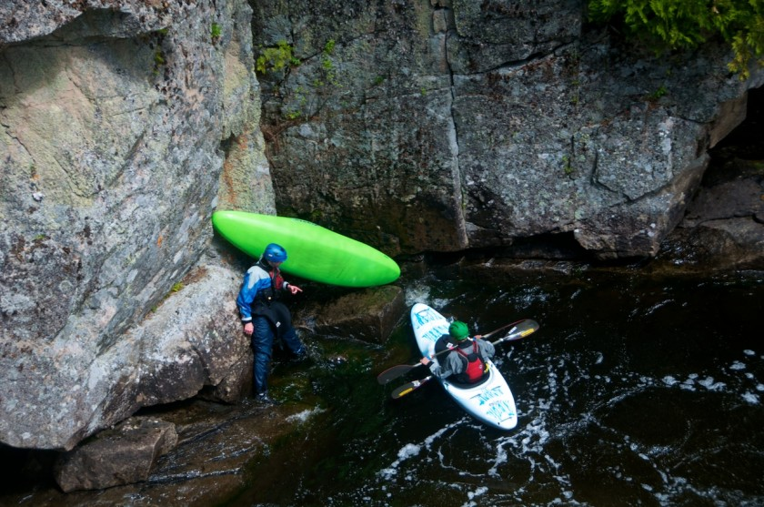 Draining my boat below Exterminator in Rip Gorge on the West Branch of the Penobscot with Peter.